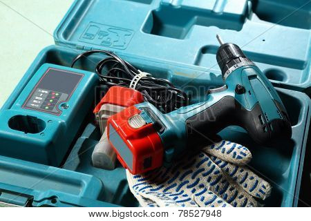 Screwdriver And Gloves In The Box