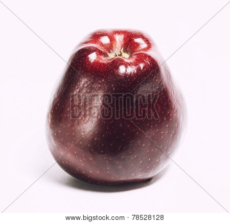 attractive teasing red apple close up isolated on white
