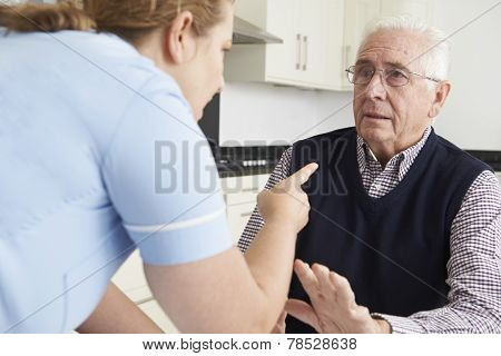 Care Worker Mistreating Elderly Man
