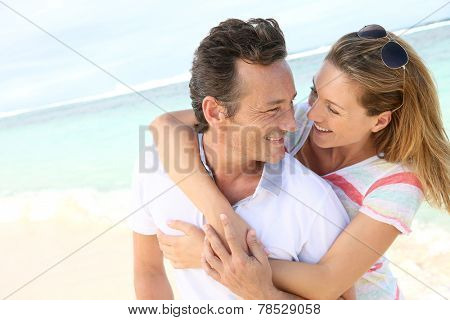 In love couple enjoying vacation at the beach