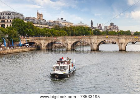 Tourists On The Pleasure Boat Goes Near Pont Neuf In Paris