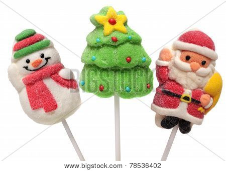 Three  New Year Sweets . Christmas Tree, Santa Claus And Snowman. Isolated On A White Background.