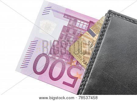 Money, credit card inside the purse.