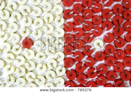 an opposition of red and white size washers
