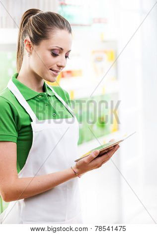 Sales Clerk With Tablet