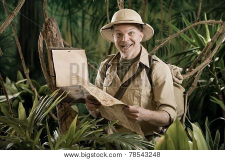 Cheerful Explorer With Blank Sign