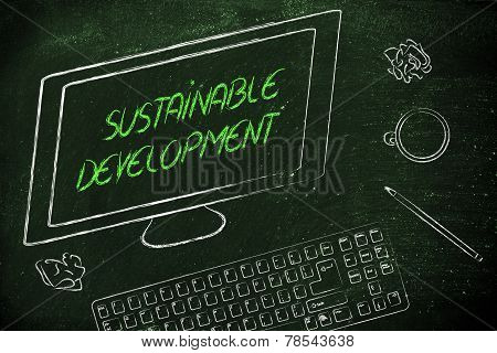 Sustainable Development Text On Computer Screen, On A Desk With Keyboard And Coffee
