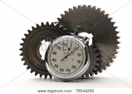 Three Steel Cogwheels And Stopwatch