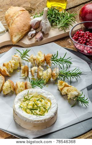 Prepareing For Baked Camembert With Garlic & Rosemary