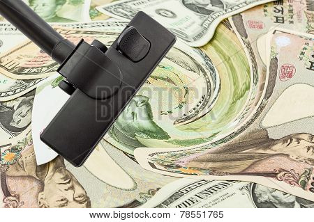Vacuum Cleaner With World Banknotes Background.