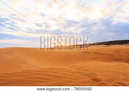 Red Sand Dune And Sunset