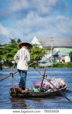 CAN THO,VIETNAM - 4 JUNE, 2011: Unidentified woman at floating market in Mekong river delta. Cai Rang and Cai Be markets are central markets in delta and became  popular tourist destination