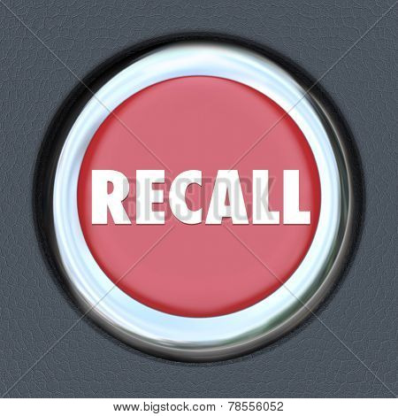 Recall word on a red round car or vehicle ignition button to illustrate a defective lemon automobile that needs to be fixed or repaired