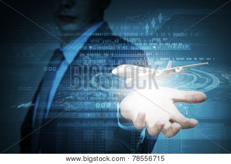 Close up of businessman at digital background with airplane in palm