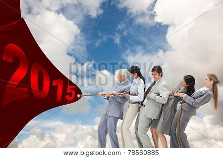 Business people pulling a rope against blue sky with white clouds