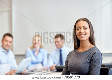 business, people and teamwork concept - smiling businesswoman with group of businesspeople meeting i