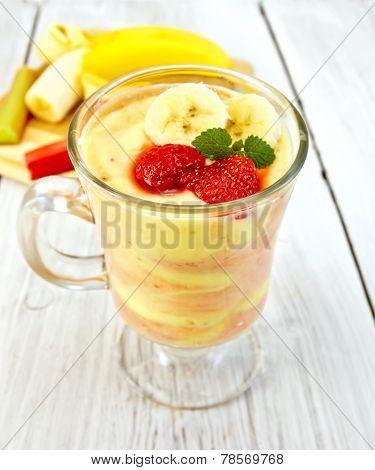 Dessert milk strawberry and banana on light board