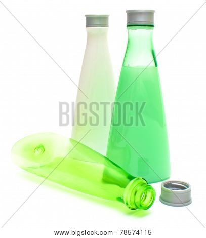 Cosmetic Bottles On White