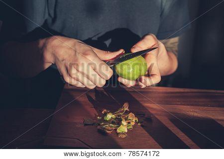 Woman Cutting A Kiwi