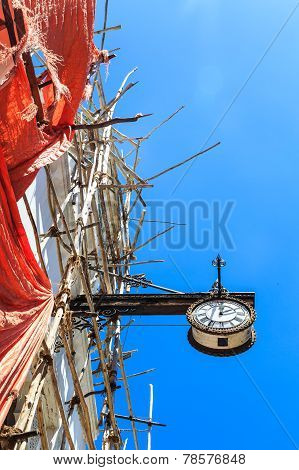 Colonial Clock Hanging On An Old Colonial Building