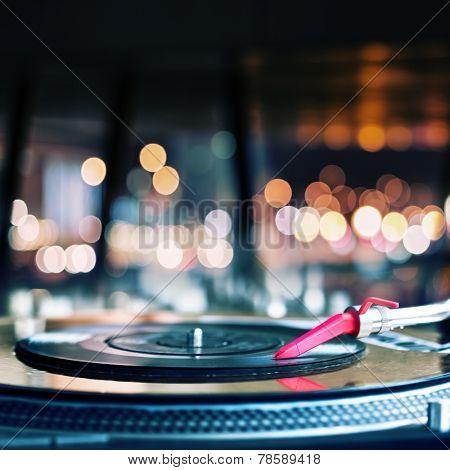 Vinyl record spinning on DJ turntable