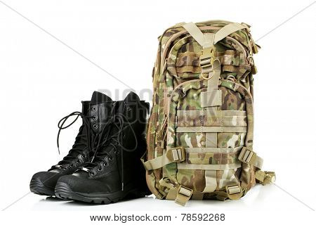 Black army boots and backpack, isolated on white