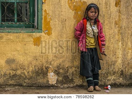 Hmong Schoolgirl Standing Against Yellow Wall.