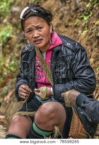 Young Hmong Woman Twisting String.