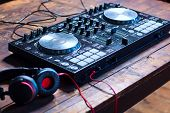 pic of mixer  - Dj mixer with headphones on wooden table close - JPG