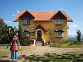 stock photo of scarecrow  - Yellow house and scarecrow in Pai - JPG