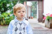 image of pretty-boy  - Funny happy and smiling blond kid boy on way to summer school nursery or kindergarten - JPG