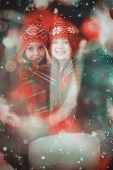 stock photo of blanket snow  - Festive little girls under a blanket against candle burning against festive background - JPG