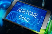 image of acetone  - the chemical formula of Acetone on a tablet with test tubes - JPG