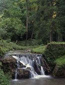 Waterfall in summer time poster
