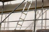 picture of scaffold  - Ladder for workers on a metal scaffold - JPG
