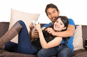 picture of indoor games  - young cute loving couple playing video games isolated on white - JPG