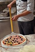 stock photo of take out pizza  - Traditional pizza ready for baked in the fire oven - JPG