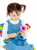 stock photo of unnatural  - Little girl holding a bouquet of flowers - JPG
