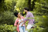 pic of tandem bicycle  - Young couple riding on the bicycle in the park - JPG