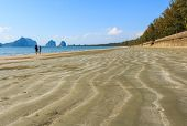 stock photo of sweethearts  - sweetheart on beach with wave of sand at Trang  - JPG