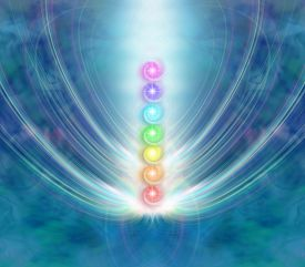stock photo of quantum  - Ethereal blue energy formation background with a central column of the seven chakras in a beam of spiraling light - JPG