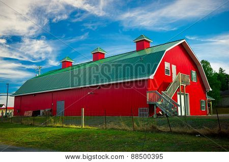Long Red Barn With Green Roof