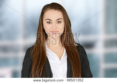 Close up of smiling young woman at the office