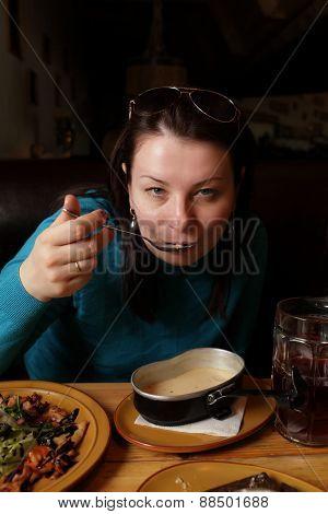 Woman Eating Fish Soup