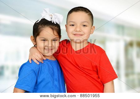 Boy and a girl hugging and smiling