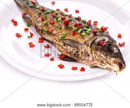 Fried fish with onion and pepper.