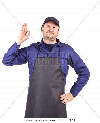 Smiling man dressed in apron.