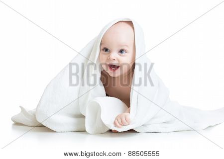 Adorable baby looking out under towel