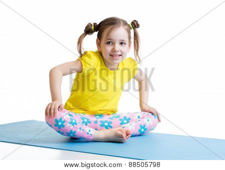 kid does gymnastics sitting in butterfly pose