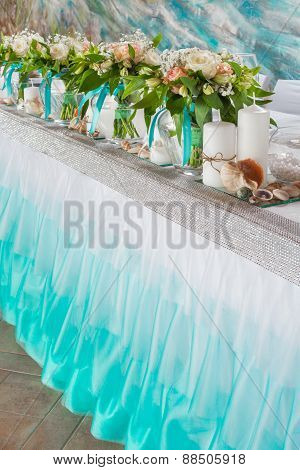 Beautiful Bouquets And Decorations On Table In Wedding Hall.